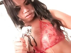 Asian ladyboy posing and stroking her cock